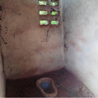 Toilet before we commenced our construction project.