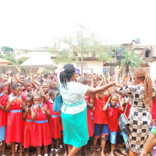 Students Cheering out of joy at the inauguration ceremony of the toilet project in Enugu, Nigeria